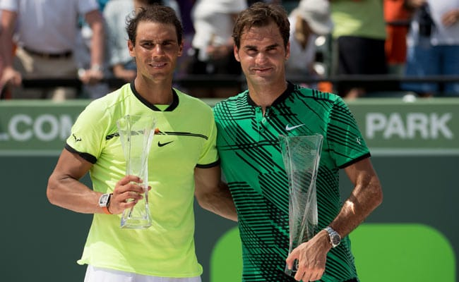 Federer and Nadal posing on the court
