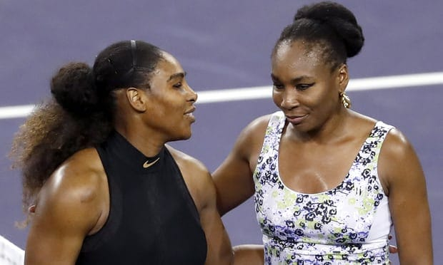 Serena and Venus Williams embracing on the court